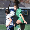 Jill Uy, of Charleston Catholic, right, heads the ball against, Graylin Floyd, of Phillip Barbour, during the semi-final match of the girls state soccer tournament held at Paul Cline Memorial Sports Complex in Beckley Friday morning.<br /> (Rick Barbero/The Register-Herald)