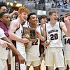 (Brad Davis/The Register-Herald) Woodrow Wilson teammates celebrate with the trophy after the Flying Eagles defeated the Princeton Tigers for Class AAA, Region 3, Section 2 Championship Friday night at the Beckley-Raleigh County Convention Center.
