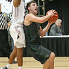 (Brad Davis/The Register-Herald) Wyoming East's Jacob Bishop drives to the basket as Bluefield's Jaylon Flack defends during the final day of Big Atlantic Classic action Saturday at the Beckley-Raleigh County Convention Center.