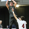 (Brad Davis/The Register-Herald) Wyoming East's Tanner Whitten pulls up for a shot as Bluefield's Caden Fuller defends during the final day of Big Atlantic Classic action Saturday at the Beckley-Raleigh County Convention Center.