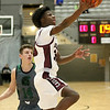 (Brad Davis/The Register-Herald) Woodrow Wilson's Dwayne Richardson sails in for a layup after getting around Hampshire's Trevor Sardo during Big Atlantic Classic action Friday at the Beckley-Raleigh County Convention Center.