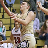 (Brad Davis/The Register-Herald) Greenbrier West's Chase Boggs drives to the basket as Independence's Michael McKinney defends Thursday night in Coal City.