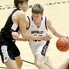 (Brad Davis/The Register-Herald) Woodrow Wilson's Ayden Ince moves up the court as University's Blake Barkley defends during the final night of Big Atlantic Classic action Saturday at the Beckley-Raleigh County Convention Center.