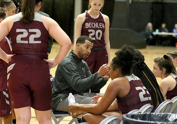 (Brad Davis/The Register-Herald) Woodrow Wilson head coach Brian Nabors talks to his team during a timeout PikeView at the New River Community and Technical College Shootout Saturday at the Beckley-Raleigh County Convention Center.