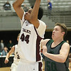 (Brad Davis/The Register-Herald) Woodrow Wilson's Jevon Ely drives to the basket as Hampshire's Zach Hill defends during Big Atlantic Classic action Friday at the Beckley-Raleigh County Convention Center.