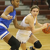 (Brad Davis/The Register-Herald) Woodrow Wilson's Cloey Frantz moves along the perimeter as Capital's Talayah Boxley defends Wednesday night in Beckley.