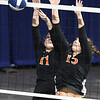 Taylor Isaac, left, and Maggie Stover, of Summers Co., block the ball against Wirt Co. during the semi-final match of the Girls State Volleyball Tournament held at the Charleston Civic Center Wednesday morning. Summers Co. lost 3 sets to 1<br /> (Rick Barbero/The Register-Herald)
