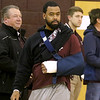 (Brad Davis/The Register-Herald) Woodrow Wilson assistant coach Gene Nabors makes his way to his team's bench prior to the start of the Lady Flying Eagles' home game against Hurricane Thursday night with his arm in a cast and sling following the incident at Greenbrier East earlier in the week.