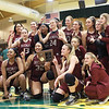 Woodrow Wilson's girls basketball team celebrates after winning the Class AAA Region 3 Section 2 championship against Greenbrier East in Fairlea Friday. (Jenny Harnish/The Register-Herald)