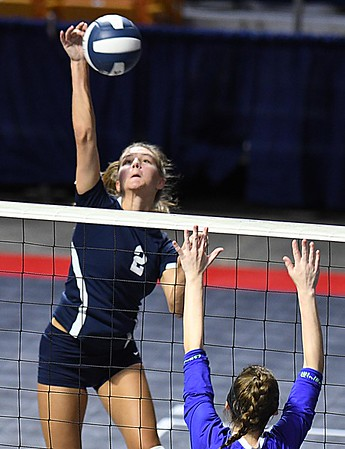 Kelsie Dangerfield, of Shady Spring, leaps high for a spike againt Robert C Byrd in the semi-final match of the Girl Calss AA State Volleyball Tournament held at the Charleston Civic Center Friday afternoon. Shady won the match 3-1<br /> (Rick Barbero/The Register-Herald)