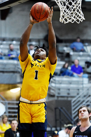 WVU Tech's Andrew Work goes up for a layup over a Alice Loyd player during their River States Conference quarterfinal game in Beckley on Wednesday. (Chris Jackson/The Register-Herald)