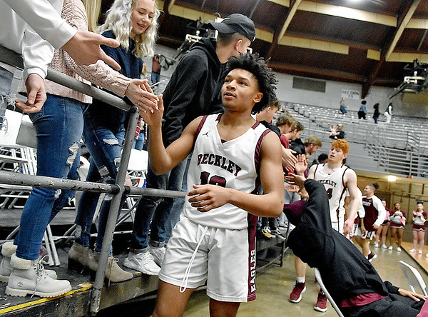 (Brad Davis/The Register-Herald) Woodrow Wilson teammates run over to celebrate with their classmates in the student section after the Flying Eagles defeated the Princeton Tigers for Class AAA, Region 3, Section 2 Championship Friday night at the Beckley-Raleigh County Convention Center.