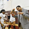 Woodrow Wilson Girls Basketball Head Coahc Brian Nabors  is sprayed with water after their beating George Washington in their Class AAA, Region Conference Final in Beckley on Tuesday. (Chris Jackson/The Register-Herald)