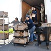 Tamarack employees and the W.Va. National Guard 115th Clarksburg unit, load up bags of meals prepared by Tamarack in Beckley Monday morning. Tamarack joined together with Raleigh County and Monroe schools to provide two meals a day for five day to 1500 students from each county. 1500 meals were delivered to Monroe County Monday morning and additional 1500 meals will be prepared and delivered in Raleigh by the W.Va. National Guard to help continue feeding students during the coroanvirus crisis.<br /> (Rick Barbero/The Register-Herald)