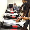 Stephanie Ellison, deputy clerk, pulls tape from machines that are being tested, Wednesday, May 20th,  before the upcoming WV primary election. Jon C. Hancock/Register-Herald
