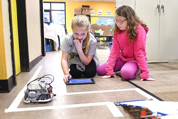 Karlie Cutlip, left and LeeAnn Walker, work together programing a robot to go over a bridge in Tonya Sexton's 4th grade STEM lab class at Shady Spring Elementary School.<br /> (Rick Barbero/The Register-Herald)