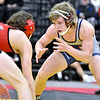 (Brad Davis/The Register-Herald) Independence's Judah Price takes on Point Pleasant's Isaac Short for the 120-pound championship Saturday night at the 73rd Annual State Wrestling Tournament in Huntington. Point Pleasant's Short won the match.