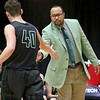 (Brad Davis/The Register-Herald) Wyoming East head coach Derek Brooks reaches out to high-five player Jacob Bishop as he comes off the court during the final day of Big Atlantic Classic action Saturday at the Beckley-Raleigh County Convention Center.