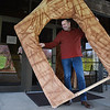 John Jordan, pastor, lifts the entrance portion of the empty tomb of Jesus that he will be displayed in a parade starting at noon Easter Sunday from Calvary Assembly of God Church on 319 Sunset Drive in Beckley.<br /> (Rick Barbero/The Register-Herald)