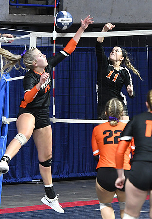 Megan Gill, of Summers Co., right, hits the ball into, Emma Wyer, of Wirt Co., during the semi-final match of the Girls State Volleyball Tournament held at the Charleston Civic Center Wednesday morning. Summers Co. lost 3 sets to 1<br /> (Rick Barbero/The Register-Herald)