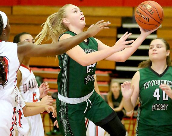 (Brad Davis/The Register-Herald) Wyoming East's Kayley Bane drives to the basket as Oak Hill's Marcayla King defends Thursday night in Oak Hill.