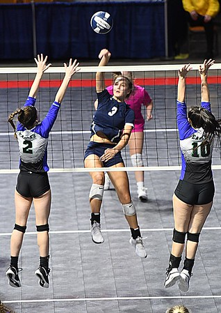 Meg Williams, of Shady Spring, center, spikes the ball between, Taylor Lough, left, and Kellie Berg, of Robert C Byrd in the semi-final match of the Girl Calss AA State Volleyball Tournament held at the Charleston Civic Center Friday afternoon. Shady won the match 3-1<br /> (Rick Barbero/The Register-Herald)