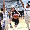 Jake Pate, Eastern Greenbrier, center, drive the lane between, Phillip law, left and Elijah Waller, of Beckley Stratton, during the Big Atlantic Classic tournament held at the Beckley Raleigh County Convention Center Tuesday afternoon. Beckley Stratton won 45-37.<br /> (Rick Barbero/The Register-Herald)