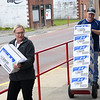 United Way of Southern West Virginia volunteers pick up boxes of nonperishable items to to be delivered to seniors and other families to help out because of COVID-19.<br /> (Rick Barbero/The Register-Herald)