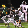 Monquelle Davis, of Greenbrier East, left, breaks away from Woodrow Wilson defenders during first half action in Fairlea Friday night.<br /> (Rick Barbero/The Register-Herald)