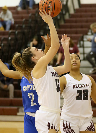 (Brad Davis/The Register-Herald) Woodrow Wilson's Cloey Frantz drives to the basket as Capital's Talayah Boxley defends Wednesday night in Beckley.