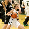 (Brad Davis/The Register-Herald) Wyoming East's Skylar Davidson drives to the basket as Westside's Lauren Thomas defends Wednesday night in New Richmond.
