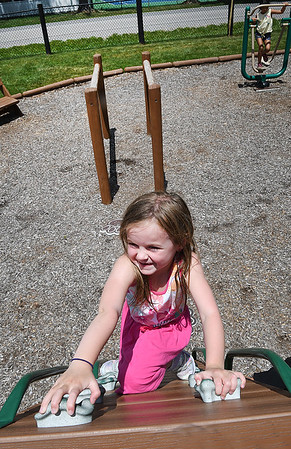 Millie Legursky, 5 enjoying her day in the playground during Camp Glade at The Resort at Glade Springs Monday afternoon.<br /> (Rick Barbero/The Register-Herald)