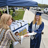 Principal Mary Ann Foster, left, hands Amethyst Paige Alexander her diploma during Shady Spring High School graduation. Due to the COVID-19 global pandemic, students at Shady Spring High School were not able to take part in the traditional graduation ceremony like students in the past, but their administration made accommodations so their parents and family members could watch them walk across the stage, receive their diplomas, and turn their tassels Friday evening in front of the school.<br /> (Rick Barbero/The Register-Herald)