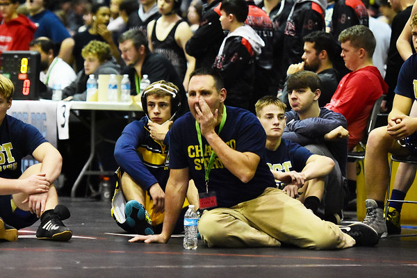 A Greenbrier West coach yells advice at the West Virginia Army National Guard Duals in Summersville on Friday. (Chris Jackson/The Register-Herald)