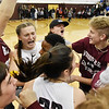 Liz Cadle, left, and Sierra Conley (22) celebrate with Woodrow WIlson students from the student section that ran onto the court after their Class AAA, Region Conference Final win over George Washington in Beckley on Tuesday. (Chris Jackson/The Register-Herald)