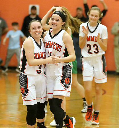 (Brad Davis/The Register-Herald) Summers County players Riley Richmond, left, and Taylor Isaac and Gavin Pivont, background right, react as the clock runs out in overtime with the Lady Bobcats on top after a close Region 3 co-final against Charleston Catholic Wednesday night in Hinton.