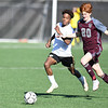 Chase Winbush, 11, of Jefferson, left, and Nicholas Ihnat, of George Washington, going after the ball during the semi-final match of the boys state soccer tournament held at Paul Cline Memorial Sports Complex in Beckley Friday morning.<br /> (Rick Barbero/The Register-Herald)