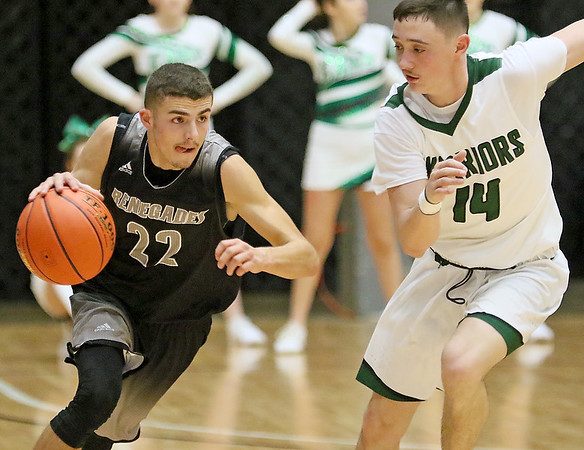 (Brad Davis/The Register-Herald) Westside's Daniel Reed pushes up the court as Wyoming East's Caden Lookabill gives chase during the New River Community and Technical College Shootout Saturday at the Beckley-Raleigh County Convention Center.