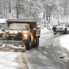 Department of Highway crew clears snow off Airport Road in Beaver Tuesday morning trying to get traffic moving after a FedEx truck and other vehicles got stuck.<br /> (Rick Barbero/The Register-Herald)