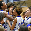 (Brad Davis/The Register-Herald) Beckley-Stratton players react in celebration after the Bulldogs defeated the Shady Spring Tigers for the Raleigh County Middle School boys basketball championship Friday night at the Beckley-Raleigh County Convention Center.