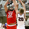 (Brad Davis/The Register-Herald) Greater Beckley's Isaiah Hairston drives to the basket as Woodrow Wilson's Ayden Ince defends Friday night at the Beckley-Raleigh County Convention Center.