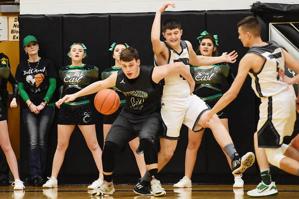 Wyoming East's Jacob Bishop (40) goes for a rebound as Westside's Tommy Millam (44) defends during the first half of their basketball game in Clear Fork on Tuesday. (Chris Jackson/The Register-Herald)