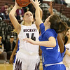 (Brad Davis/The Register-Herald) Woodrow Wilson's Olivia Zolkowski drives and scores as Capital's Abbie Robinson defends Wednesday night in Beckley.
