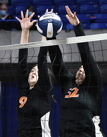 Alyvia Harvey, left, and Danielle Midkiff, of Summers Co., blocks a ball hit by Wirt Co., during the semi-final match of the Girls State Volleyball Tournament held at the Charleston Civic Center Wednesday morning. Summers Co. lost 3 sets to 1<br /> (Rick Barbero/The Register-Herald)