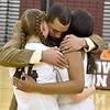 (Brad Davis/The Register-Herald) Head coach Brian Nabors hugs senior players Victoria Staunton (#23) and Liz Cadle (#24) prior to the Lady Flying Eagles' game against South Charleston Wednesday night in Beckley.