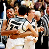 Westside's Jace Colucci hugs Wesley Browning (33) after their win against Independence during their Class AA Region 3, Section 1 championship basketball game in Beckley on Thursday. (Chris Jackson/The Register-Herald)