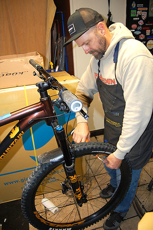 Max Hammer, of Hammer Cycles, works on a mountain bike at his shop located in White Sulphur Springs. Hammer Cycles offers a full compliment of bicycle maintenance services.<br /> (Christian M. Giggenbach/for The Register-Herald)