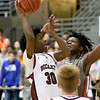 (Brad Davis/The Register-Herald) Woodrow Wilson's Dwayne Richardson drives to the basket as Cabell Midland's K.K. Siebert defends Thursday night at the Beckley-Raleigh County Convention Center.