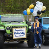 Caleb Lilly waits in the parking lot at Shady Spring High School to receive his diploma. Due to the COVID-19 global pandemic, students at Shady Spring High School were not able to take part in the traditional graduation ceremony like students in the past, but their administration made accommodations so their parents and family members could watch them walk across the stage, receive their diplomas, and turn their tassels Friday evening in front of the school.<br /> (Rick Barbero/The Register-Herald)