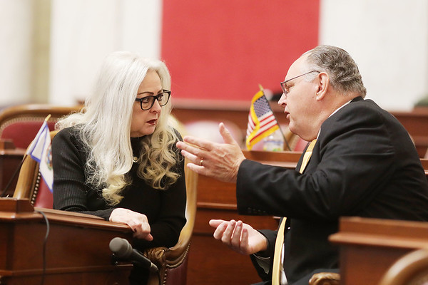 West Virginia Senators Sue Cline, (R -Wyoming), and Rollan Roberts, (R - Raleigh), speak during a recess in the senate chambers during opening day of the West Virginia Legislative Session in Charleston, W.Va., Wednesday, January 8, 2020. (Chris Jackson/The Register-Herald)
